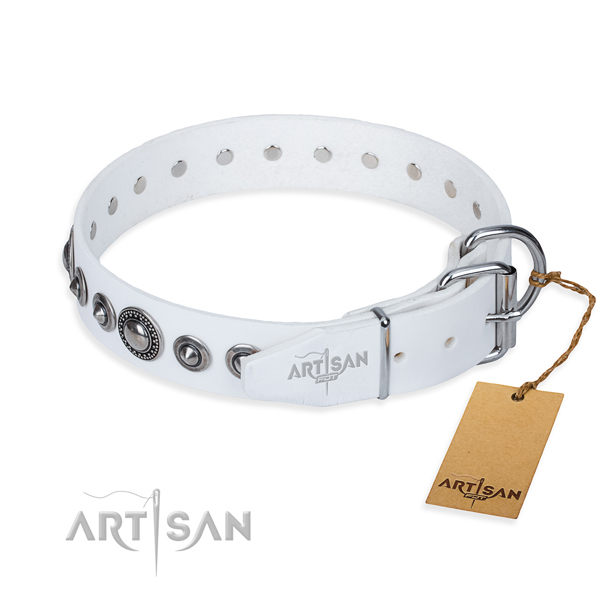 Leather dog collar made of soft to touch material with durable studs