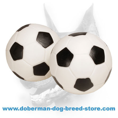 Doberman dog training ball that makes sound when squeezed